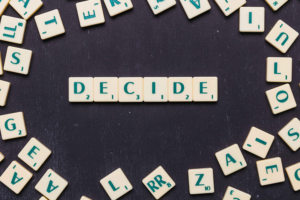word-decide-in-scrabble-letters-over-black-backdrop-low